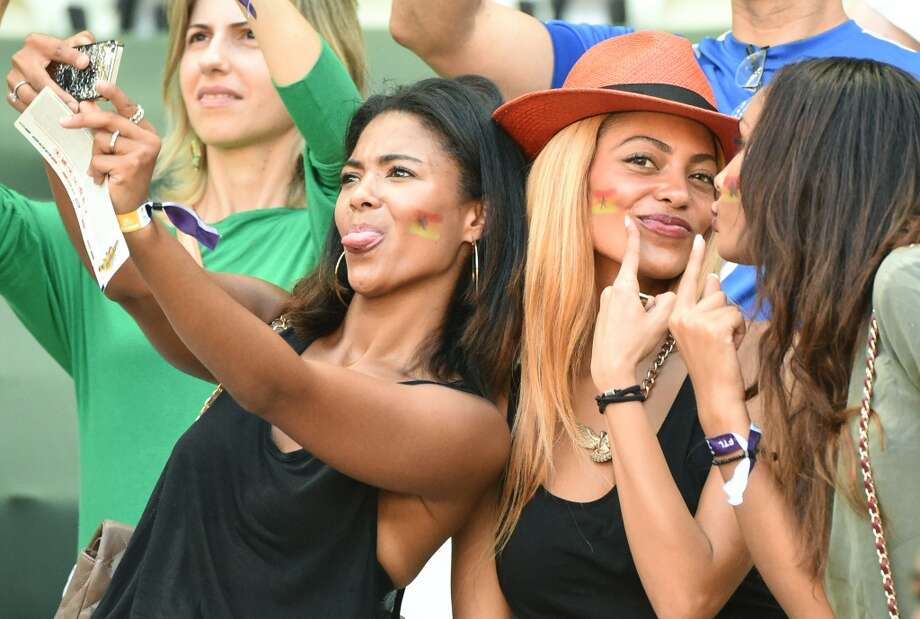 Ghanaian fans take a selfie prior to a Group G football match between Germany and Ghana at the Castelao Stadium in Fortaleza during the 2014 FIFA World Cup on June 21, 2014.   AFP PHOTO/ PATRIK STOLLARZ        (Photo credit should read PATRIK STOLLARZ/AFP/Getty Images) Photo: AFP/Getty Images