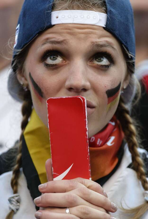 A German fan reacts during the public viewing near the Brandenburg Gate in Berlin, Germany on June 21, 2014 of the FIFA World Cup 2014 group G football match Germany vs Ghana played in Fortaleza, Brazil. AFP PHOTO / CLEMENS BILAN        (Photo credit should read CLEMENS BILAN/AFP/Getty Images) Photo: AFP/Getty Images