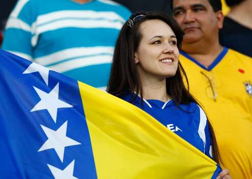 CUIABA, BRAZIL - JUNE 21:  A Bosnia-Herzegovin fan shows her colours ahead of the 2014 FIFA World Cup Group F match between Nigeria and Bosnia-Herzegovina at Arena Pantanal on June 21, 2014 in Cuiaba, Brazil.  (Photo by Matthew Lewis/Getty Images) Photo: Getty Images