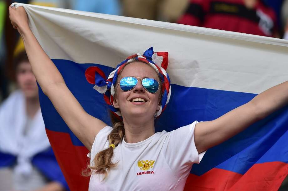 A Russian supporter cheers for her team ahead of the Group H football match between Belgium and Russia at The Maracana Stadium in Rio de Janeiro on June 22, 2014, during the 2014 FIFA World Cup. AFP PHOTO / GABRIEL BOUYS        (Photo credit should read GABRIEL BOUYS/AFP/Getty Images) Photo: AFP/Getty Images