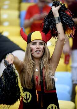 A Belgium's fan poses as she waits for the start of the Group H football match between Belgium and Russia at the Maracana Stadium in Rio de Janeiro during the 2014 FIFA World Cup on June 22, 2014.  AFP PHOTO / MARTIN BUREAU        (Photo credit should read MARTIN BUREAU/AFP/Getty Images) Photo: AFP/Getty Images