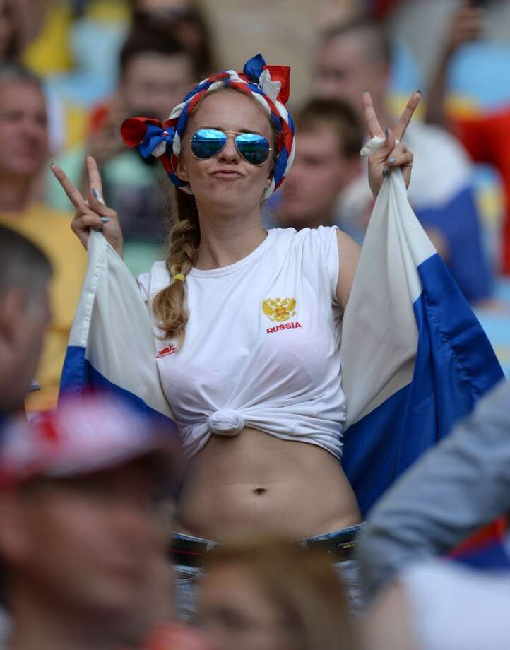 RIO DE JENEIRO, BRAZIL - JUNE 22: A Russian female soccer fan poses as she waits at the Maracana Stadium for the 2014 FIFA World Cup Group H game between Belgium and Russia in Rio De Jeneiro, Brazil on June 22, 2014. (Photo by Metin Pala/Anadolu Agency/Getty Images) Photo: Getty Images