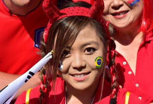 South Korea's fans are pictured outside the stadium before the start of a Group H match between South Korea and Algeria at the Beira-Rio Stadium in Porto Alegre during the 2014 FIFA World Cup on June 22, 2014.  AFP PHOTO / JUNG YEON-JE        (Photo credit should read JUNG YEON-JE/AFP/Getty Images) Photo: AFP/Getty Images
