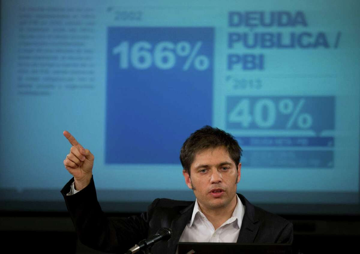 FILE - In this June 17, 2014 file photo, Argentina's Economy MInister Axel Kicillof talks to the media during a news conference to explain the recent U.S. Supreme Court's ruling on Argentina's bond default and discuss how the government plans to proceed, in Buenos Aires, Argentina. For over a decade, Argentina avoided paying $1.5 billion it owed to U.S. hedge funds for defaulted bonds. But after the U.S. Supreme Court refused to intervene in the case this week, the country must pay up by the end of this month. (AP Photo/Eduardo Di Baia, File) ORG XMIT: NYBZ227