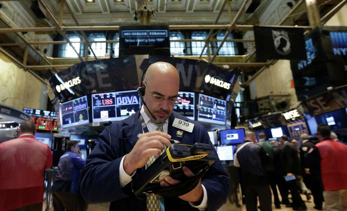 Trader Luigi Muccitelli works on the floor of the New York Stock Exchange Monday, June 23, 2014. Stocks are edging lower in early trading after indexed closed last week at record highs. (AP Photo/Richard Drew) ORG XMIT: NYRD106