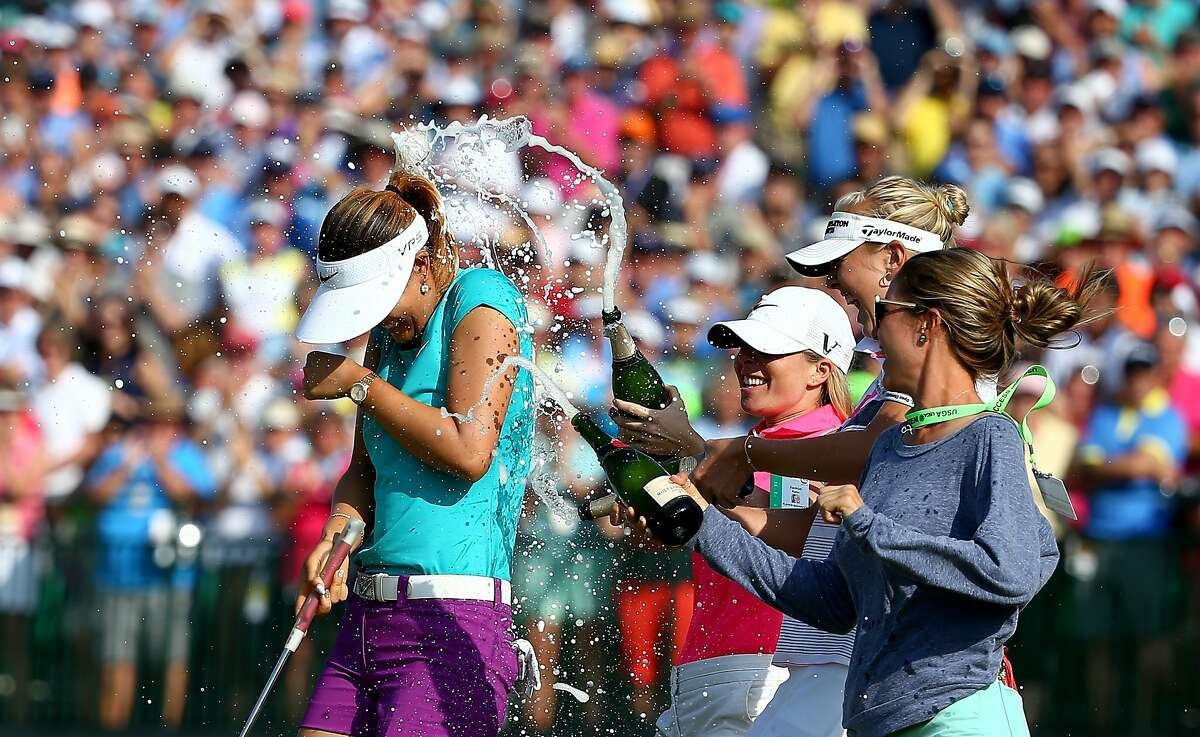 PINEHURST, NC - JUNE 22: (L-R) Michelle Wie of the United States is sprayed with champagne by Jamie Kuhn, Jessica Korda and Jaye Marie Green after the final round of the 69th U.S. Women's Open at Pinehurst Resort & Country Club, Course No. 2 on June 22, 2014 in Pinehurst, North Carolina. (Photo by Streeter Lecka/Getty Images)
