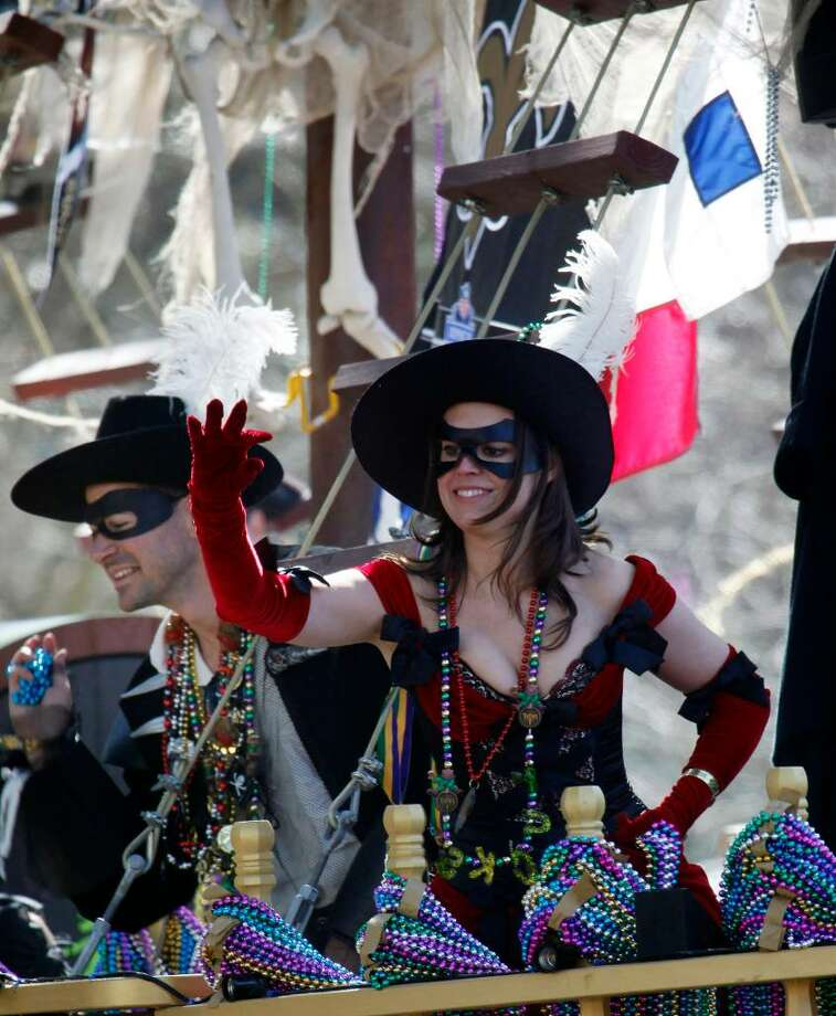 A masked Mardi Gras float rider waves to the crowd after tossing beads during the Tucks parade as it marches through the streets of New Orleans  Saturday, Feb. 13, 2010. This is the last full weekend of parades before Tuesday's all day celebration of Mardi Gras. (AP Photo/Bill Haber) Photo: Bill Haber, AP / FR170136 AP