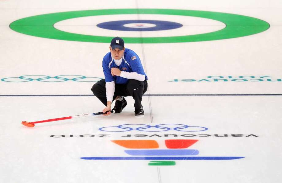 VANCOUVER, BC - FEBRUARY 16:  Skip John Shuster of the United States watches his stone during the men's curling round robin game between Germany and the United States on day 5 of the Vancouver 2010 Winter Olympics at Vancouver Olympic Centre on February 16, 2010 in Vancouver, Canada. (Photo by Cameron Spencer/Getty Images) *** Local Caption *** John Shuster Photo: Cameron Spencer, Getty Images / 2010 Getty Images