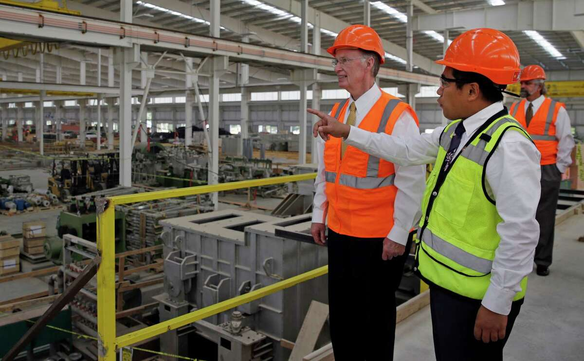 In this Aug. 29, 2013 photo provided by the Alabama Governor's office, Gov. Robert Bentley, left, listens to Roger Zhang, Golden Dragon U.S.A. President, during a tour of the new Golden Dragon copper tubing plant, then under construction, in Pine Hill, Ala. Golden Dragon, the first company Bentley recruited to Alabama after being elected, will employ 300 new full-time employees in rural Wilcox County. (AP Photo/Alabama Governor's Office, Jamie Martin) ORG XMIT: NYBZ274
