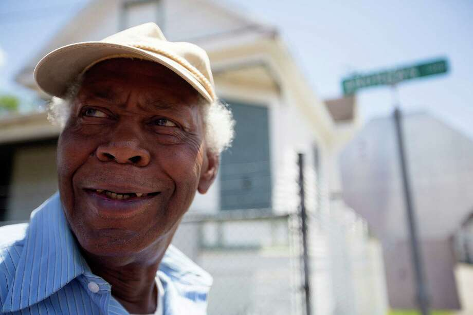 """Community leader, Lenwood Johnson, said the brick streets need to stay intact along Andrews at Wilson Streets in the Fourth Ward Thursday, June 19, 2014, in Houston.  Johnson said that the streets are paved with more than just bricks, they are paved with the history of Houston's freed slaves. """"Folklore tells us that these streets are paved with handmade bricks of those organized by a Rev. Jeremiah,"""" Lenwood said. """"They need to put the utilities under the sidewalks and keep the brick as is. If you remove the bricks and put them in sand the rain will push the sand out and then you have uneven streets."""" Photo: Johnny Hanson, Houston Chronicle / © 2014  Houston Chronicle"""