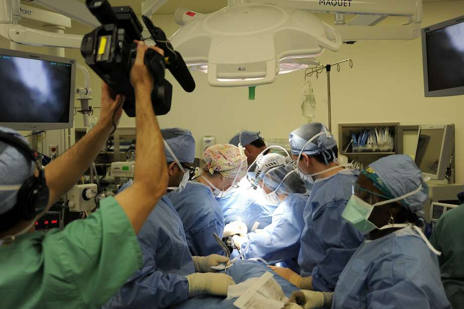 "A cameraman records a surgical procedure in an operating room during the production of ""NY Med,"" a new non-fiction medical series airing on ABC. Photo: Donna Svennevik, Associated Press"