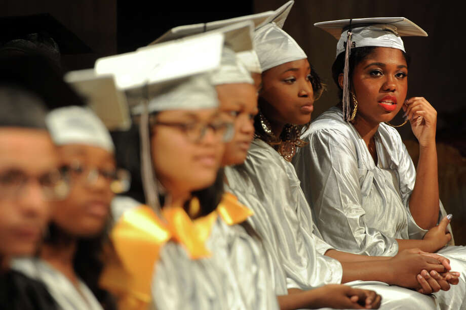 Asia Prince, far right, attends Commencement Exercises for The Bridge Academy Class of 2014, held at Thurgood Marshall School, in Bridgeport, Conn. June 23, 2014. Photo: Ned Gerard / Connecticut Post