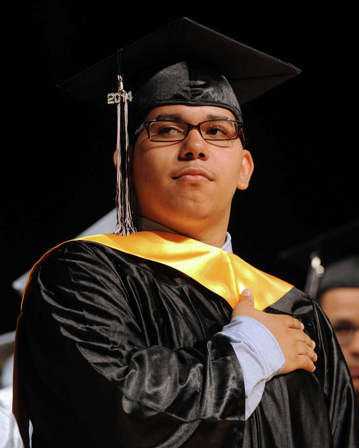 Carlos Arguelles attends Commencement Exercises for The Bridge Academy Class of 2014, held at Thurgood Marshall School, in Bridgeport, Conn. June 23, 2014. Photo: Ned Gerard / Connecticut Post