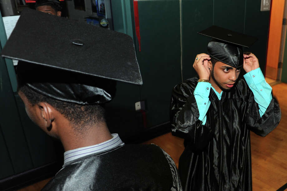 Luis Carrasquillo and his classmates prepare for Commencement Exercises for The Bridge Academy Class of 2014, held at Thurgood Marshall School, in Bridgeport, Conn. June 23, 2014. Photo: Ned Gerard / Connecticut Post