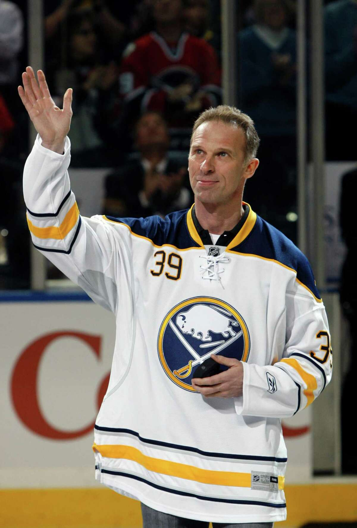 FILE - In this March 19, 2011 file photo, Buffalo Sabres former goalie Dominik Hasek waves to the fans during a pre-game ceremony before an NHL hockey game against the Atlanta Thrashers in Buffalo, N.Y. Hasek is expected to be part of the class of 2014 at the Hockey Hall of Fame, which will be announced Monday, June 23, 2014. (AP Photo/David Duprey, File) ORG XMIT: NY116