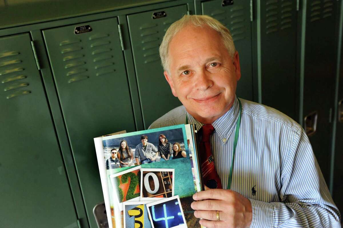 Superintendent Michael Mugits holds a yearbook showing the senior class comprised of five students on Tuesday, June 17, 2014, at Heatly School in Green Island, N.Y. (Cindy Schultz / Times Union)