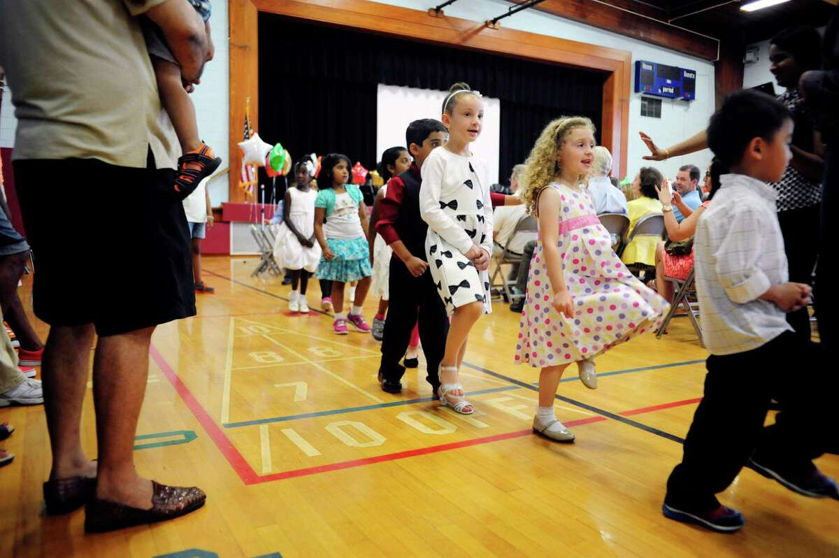 Kindergarteners march to the back of the gym at the end of their moving up ceremony at Menands School on Monday, June 23, 2014, in Menands, N.Y. (Paul Buckowski / Times Union)