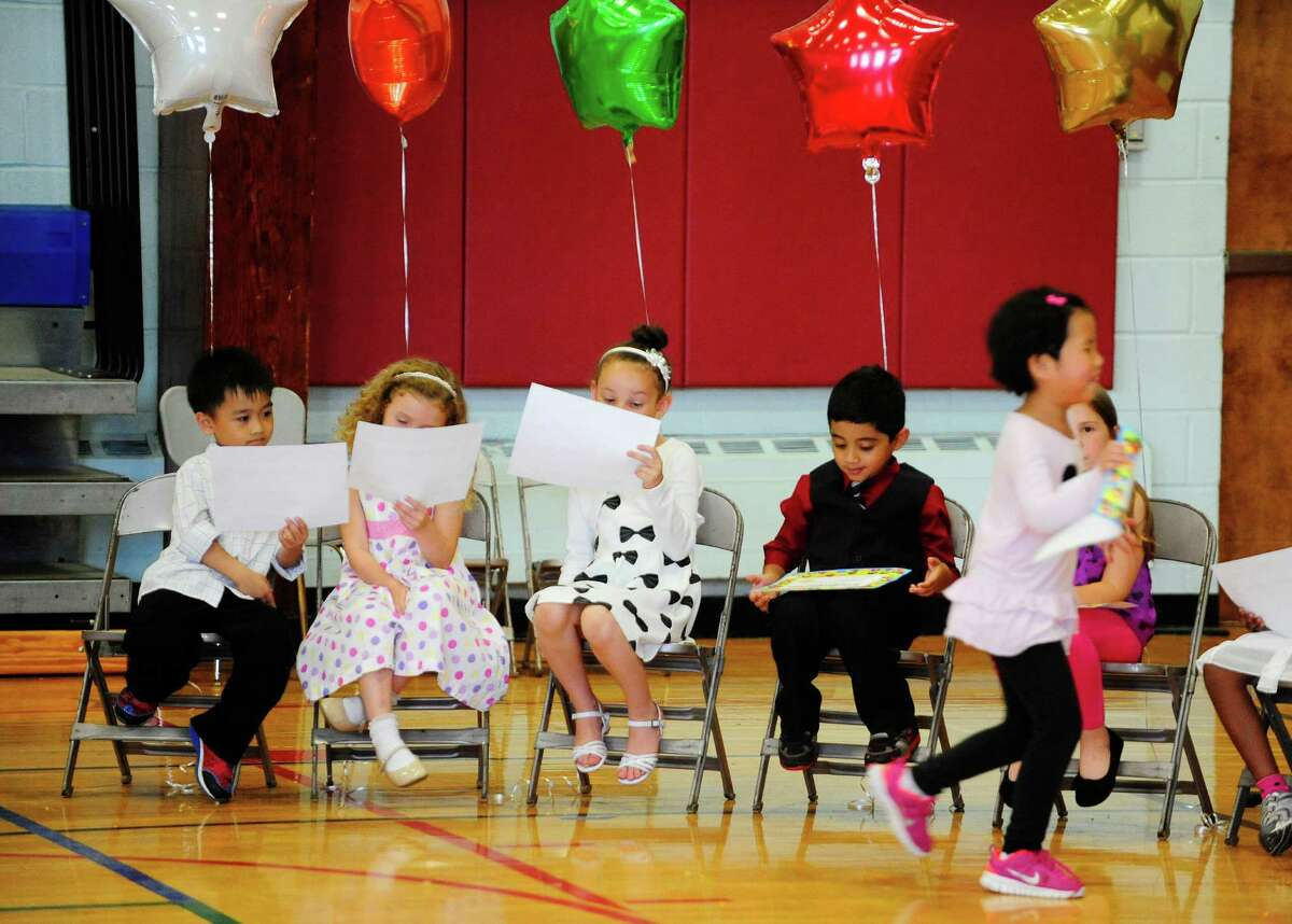Kindergarteners look over their certificate during a moving up ceremony for the kindergarten class at Menands School on Monday, June 23, 2014, in Menands, N.Y. (Paul Buckowski / Times Union)
