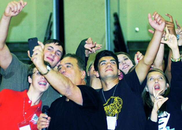 "Graduates enjoy creating what could best be described as ""air selfies"" while participating in hypnotist Dan LaRosa's show during the New Milford High School Grad Party, June 21-22, 2014 at NMHS. Photo: Norm Cummings / The News-Times"
