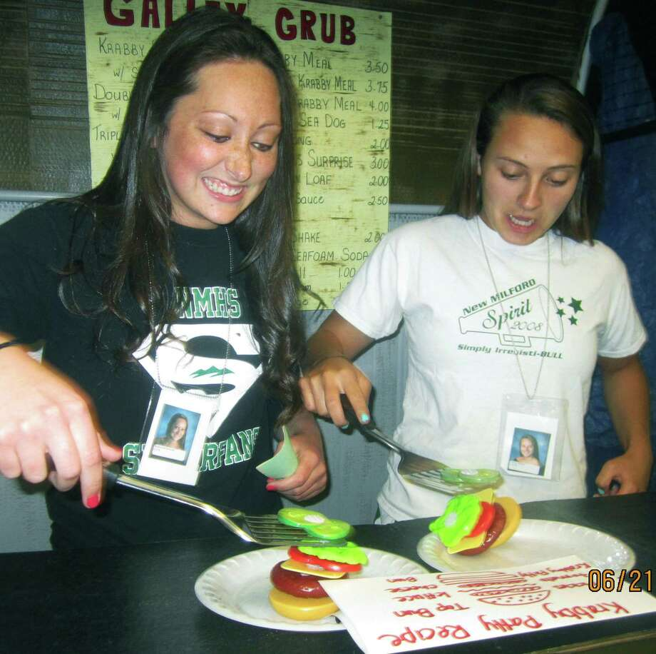 Mackenzie Bessette, left, and Nicole Sheehy match culinary talents while making SpongeBob SquarePants' favored Krabby Patty during the New Milford High School Grad Party, June 21-22, 2014 at NMHS. Photo: Norm Cummings / The News-Times