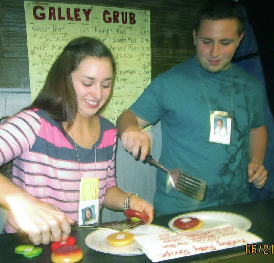 Sabriya Caceres and Sean Lavery match culinary talents while making SpongeBob SquarePants' favored Krabby Patty during the New Milford High School Grad Party, June 21-22, 2014 at NMHS. Photo: Norm Cummings / The News-Times