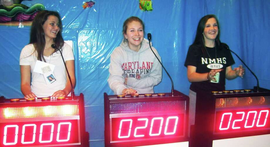 Having fun while challenging their brains as they did as NMHS students are, from left to right, grads Maren Harcken, Samantha Quinn and Alexis Kersten during the New Milford High School Grad Party, June 21-22, 2014 at NMHS. Photo: Norm Cummings / The News-Times