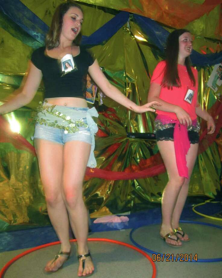 "Alexa Sullivan, left, and Alexis Yancoskie demonstrate their skills at the ""Shimmy Shack""  during the New Milford High School Grad Party, June 21-22, 2014 at NMHS. Photo: Norm Cummings / The News-Times"