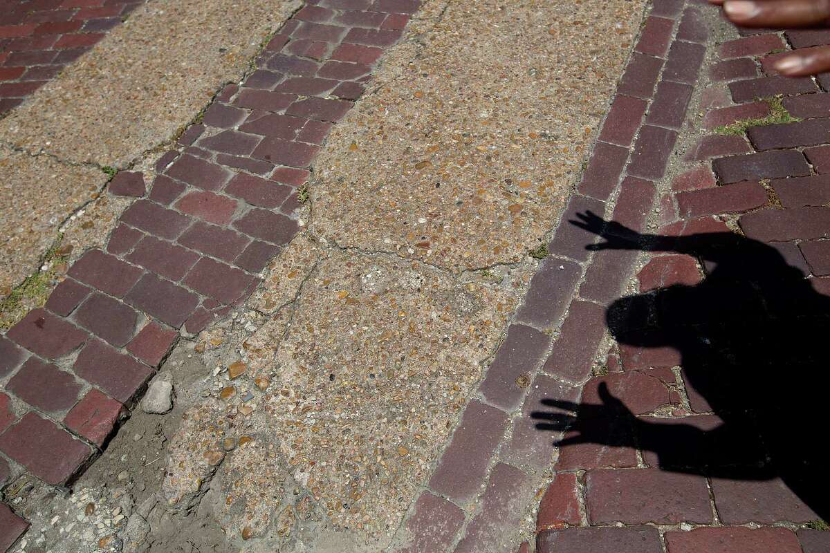 Community leader, Lenwood Johnson, says the brick streets in Freedmen's Town need to stay intact because the patterns form a story. Activists want a public works project to avoid disturbing the bricks.