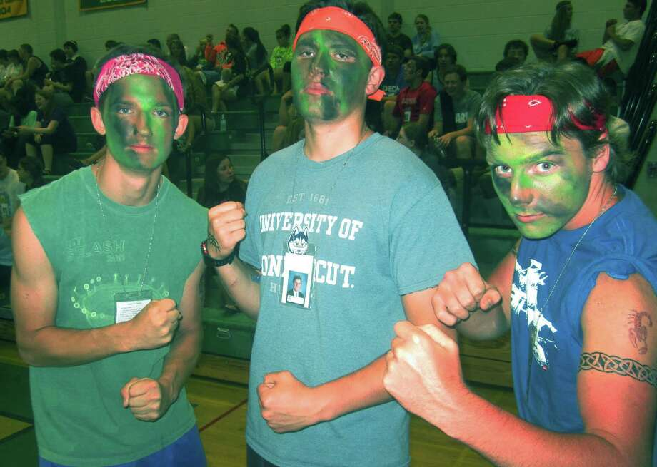 Presenting a fearsome sight hours after their graduation are, from left to right, grads Jack Laucius, Parker Martin and David Kuhn during the New Milford High School Grad Party, June 21-22, 2014 at NMHS. Photo: Norm Cummings / The News-Times