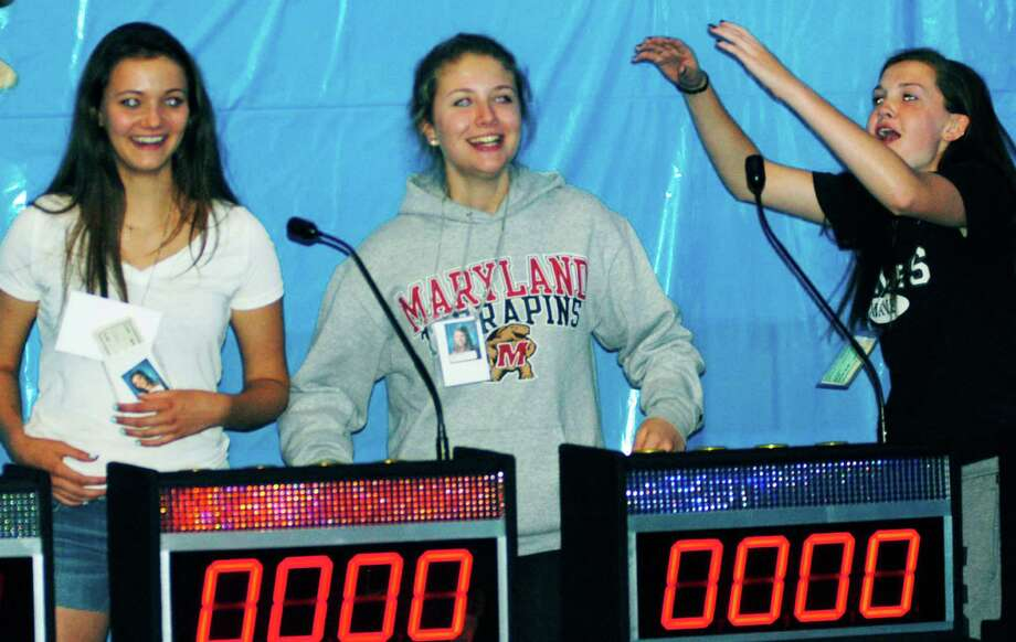 Grads, from left to right, Maren Harcken, Samantha Quinn and Alexis Kersten test their wits on a quiz show during the New Milford High School Grad Party, June 21-22, 2014 at NMHS. Photo: Norm Cummings / The News-Times