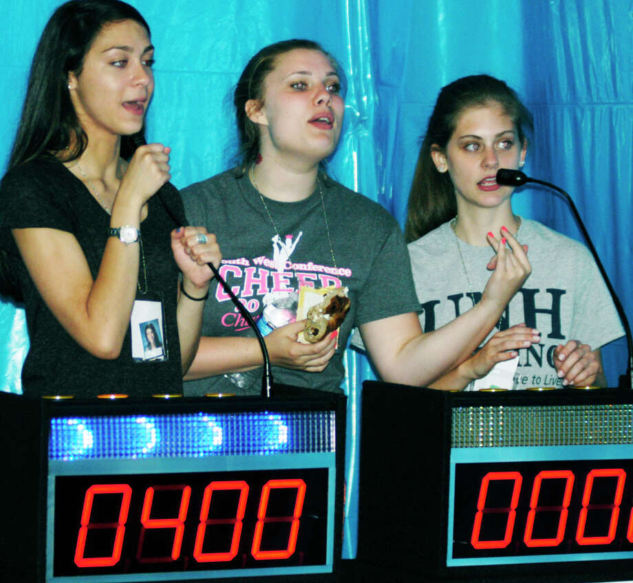 Enjoying the fun challenge of a quiz show are, from left to right, Marina Leibowiz, Sara Fein and Kiley Feulner during the New Milford High School Grad Party, June 21-22, 2014 at NMHS. Photo: Norm Cummings / The News-Times