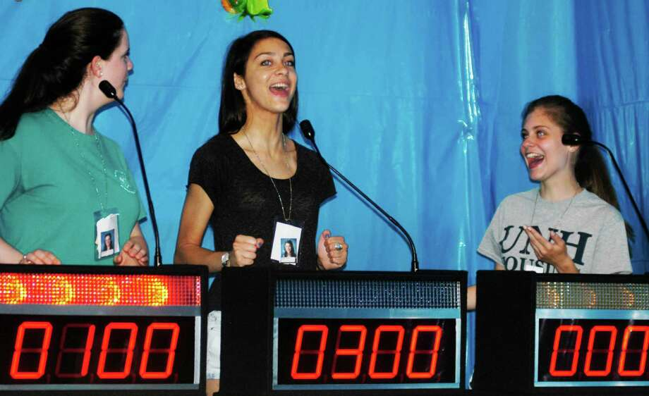 Enjoying the fun challenge of a quiz show are, from left to right, Jessica Bowe, Marina Leibowiz and Kiley Feulner during the New Milford High School Grad Party, June 21-22, 2014 at NMHS. Photo: Norm Cummings / The News-Times