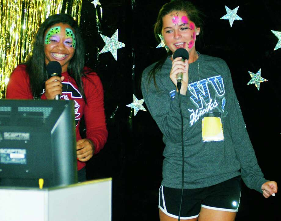 Ashley O'Berry, left, and Carolyn O'Hara let it rip with their karaoke performance during the New Milford High School Grad Party, June 21-22, 2014 at NMHS. Photo: Norm Cummings / The News-Times