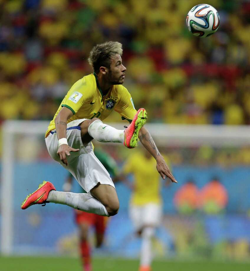 Brazil's Neymar leaves to stop a pass during the group A World Cup soccer match between Cameroon and Brazil at the Estadio Nacional in Brasilia, Brazil, Monday, June 23, 2014. (AP Photo/Natacha Pisarenko) ORG XMIT: WCDP197 Photo: Natacha Pisarenko / AP