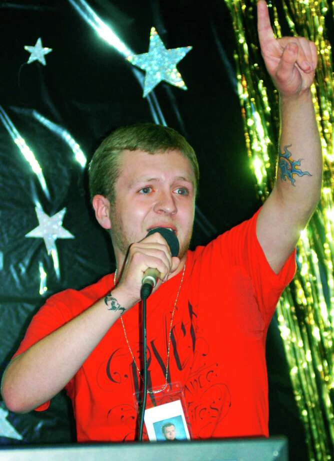 James Short offers his best Eminem as he performs karaoke-style during the New Milford High School Grad Party, June 21-22, 2014 at NMHS. Photo: Norm Cummings / The News-Times