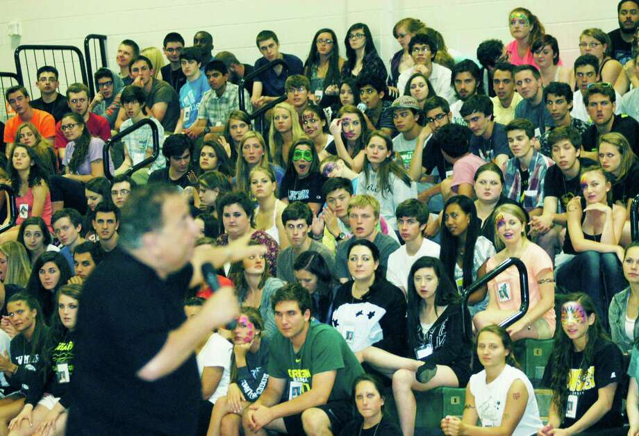 Hypnotist Dan LaRosa enjoys the rapt attention of the graduates during the New Milford High School Grad Party, June 21-22, 2014 at NMHS. Photo: Norm Cummings / The News-Times