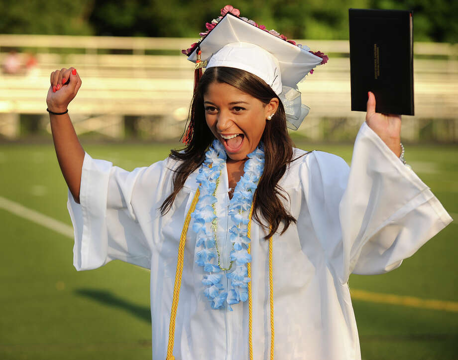 Graduate Samantha Barschow celebrates receiving her diploma at the Shelton High School Graduation in Shelton, Conn. on Monday, June 23, 2014. Photo: Brian A. Pounds / Connecticut Post