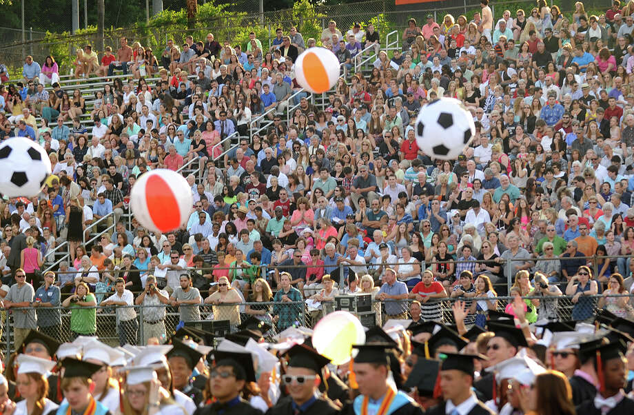 Beach balls fly above the graduates in front of packed stands at the Shelton High School Graduation in Shelton, Conn. on Monday, June 23, 2014. Photo: Brian A. Pounds / Connecticut Post