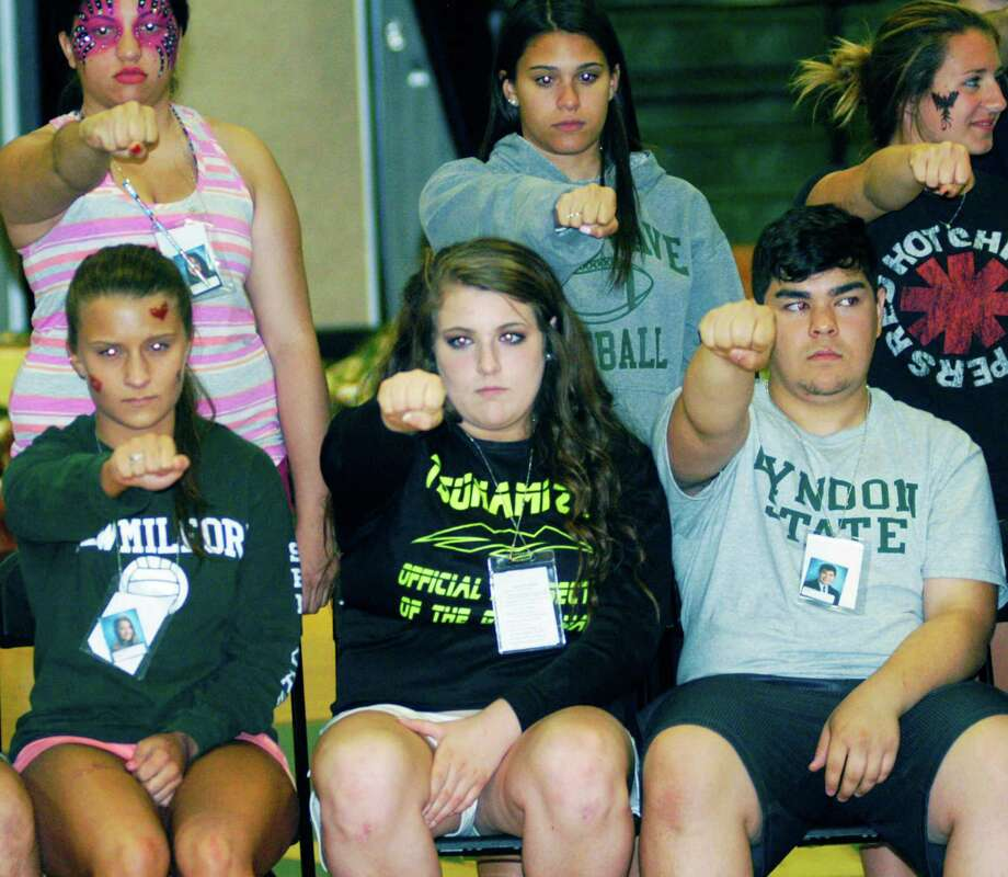 Graduates prove apt subjects for hypnotist Dan LaRosa's show during the New Milford High School Grad Party, June 21-22, 2014 at NMHS. Photo: Norm Cummings / The News-Times
