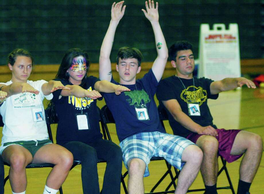 Graduates participate in hypnotist Dan LaRosa's show during the New Milford High School Grad Party, June 21-22, 2014 at NMHS. Photo: Norm Cummings / The News-Times
