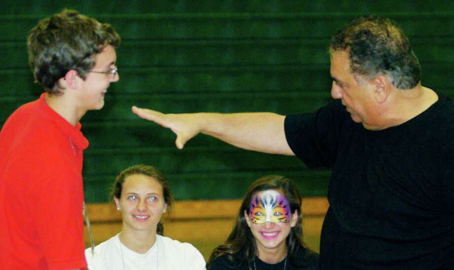 Graduates do their best to prove apt subjects for hypnotist Dan LaRosa's show during the New Milford High School Grad Party, June 21-22, 2014 at NMHS. Photo: Norm Cummings / The News-Times