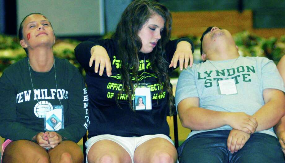 Graduates relax under the hypnotic suggestion of Dan LaRosa during the New Milford High School Grad Party, June 21-22, 2014 at NMHS. Photo: Norm Cummings / The News-Times
