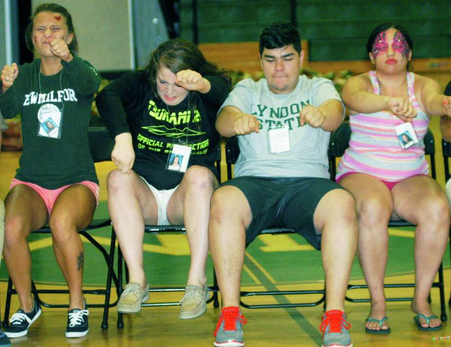 The Triple Crown horse races may be over for 2014 but that didn't stop graduates from play-acting as jockeys as part of hypnotist Dan LaRosa's show during the New Milford High School Grad Party, June 21-22, 2014 at NMHS. Photo: Norm Cummings / The News-Times