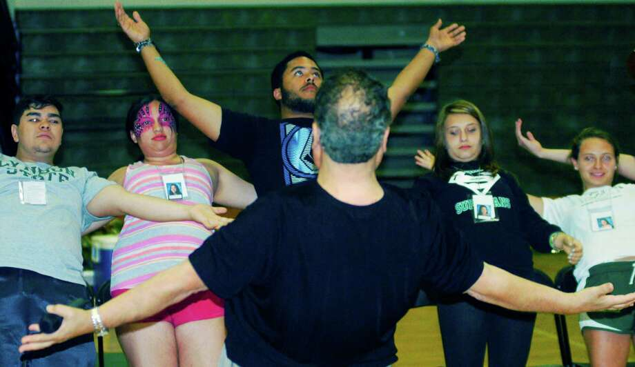 Hypnotist Dan LaRosa works his genius with willing graduates during the New Milford High School Grad Party, June 21-22, 2014 at NMHS. Photo: Norm Cummings / The News-Times