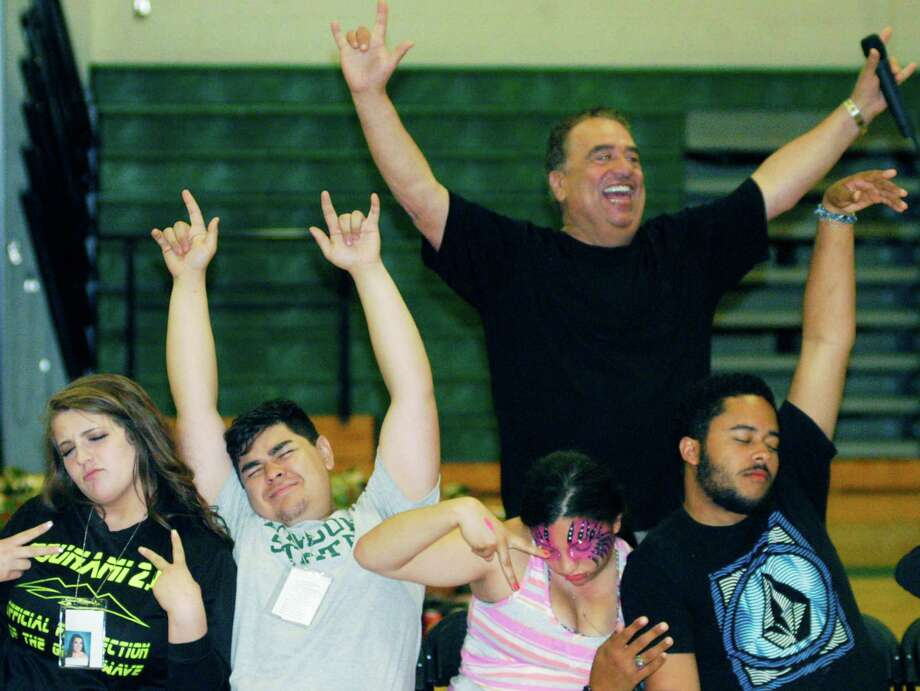 Graduates feel especially good about themselves while participating in hypnotist Dan LaRosa's show during the New Milford High School Grad Party, June 21-22, 2014 at NMHS. Photo: Norm Cummings / The News-Times