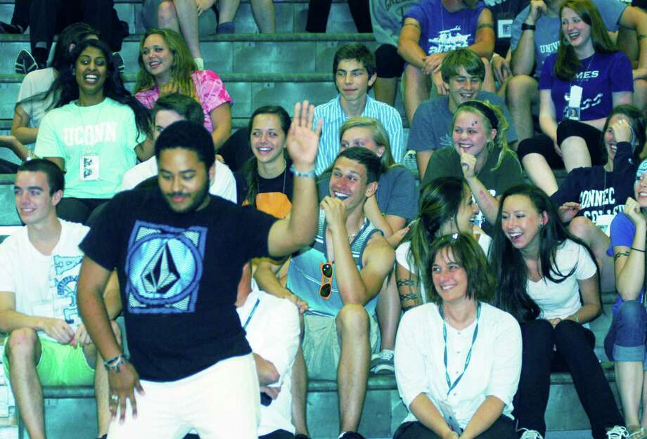 Fellow graduates enjoy hypnotist Dan LaRosa's show during the New Milford High School Grad Party, June 21-22, 2014 at NMHS. Photo: Norm Cummings / The News-Times