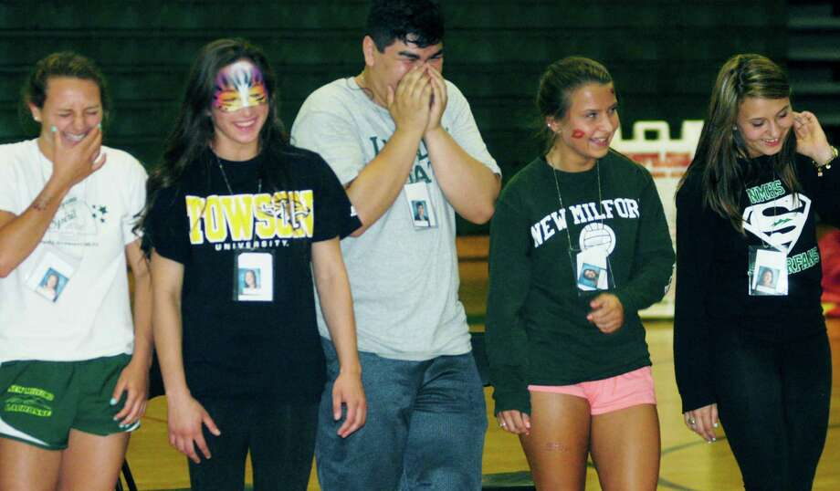Graduates experience a wide range of emotions while participating in hypnotist Dan LaRosa's show during the New Milford High School Grad Party, June 21-22, 2014 at NMHS. Photo: Norm Cummings / The News-Times