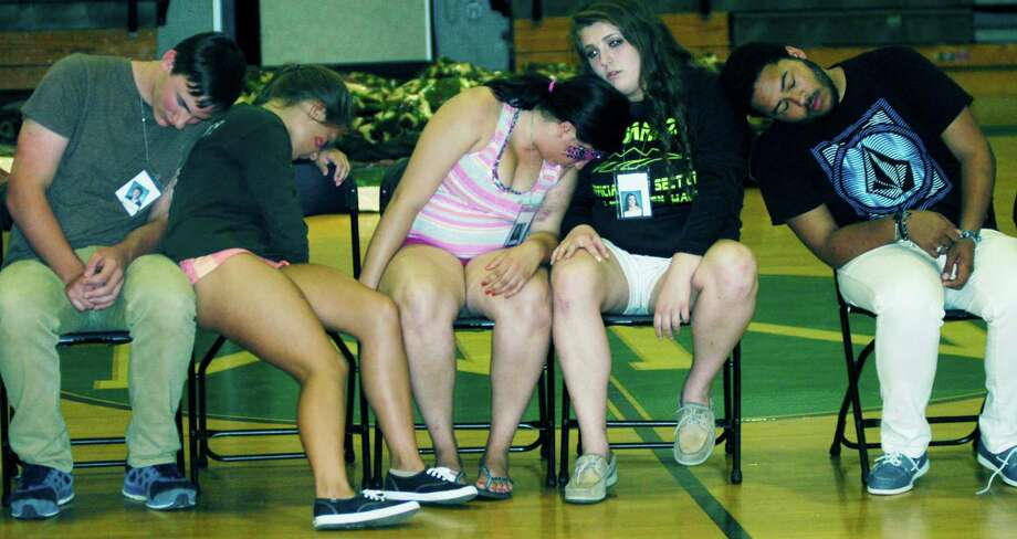One last time, graduates fall asleep whiile participating in hypnotist Dan LaRosa's show during the New Milford High School Grad Party, June 21-22, 2014 at NMHS. Photo: Norm Cummings / The News-Times
