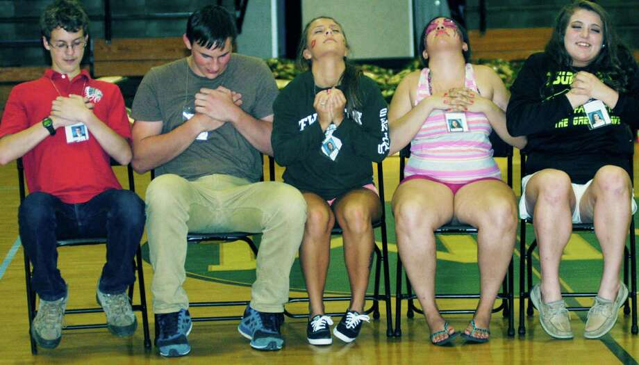 Their participation in hypnotist Dan LaRosa's show leaves graduates feeling especially good about themselves during the New Milford High School Grad Party, June 21-22, 2014 at NMHS. Photo: Norm Cummings / The News-Times