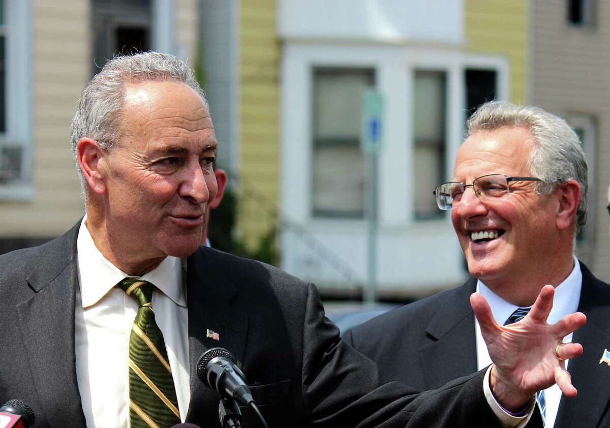 U.S. Senator Charles E. Schumer, left, and Troy Mayor Lou Rosamilia, right, announced a campaign to fight for Community Development Block Grant Program funding (CDBG) during a news conference Monday, June 23, 2014, in Troy N.Y. In order to eligible for CDBG funding a metropolitan city must have a population of at least 50,000. In 2012, Troy had a population of 50,072, but that number recently slipped to 49,946 ? just 54 residents short. (Selby Smith / Special to the Times Union)